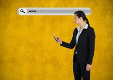 Woman with phone and Search Bar with yellow grunge background. Digital composite of Woman with phone and Search Bar with yellow grunge background stock photography