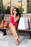 Woman with phone shopping break Royalty Free Stock Photos