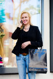 Woman with phone shopping in the city Stock Photos