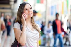Woman at the phone in a shopping mall Royalty Free Stock Images