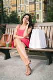 Woman on the phone after shopping Royalty Free Stock Photography