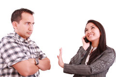 Woman on the phone signaling his couple to hold Stock Image