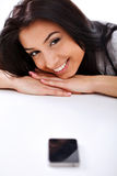 Woman with phone smiling Stock Photography