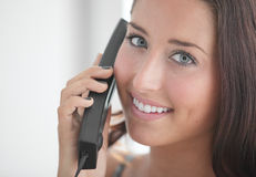 Woman on the phone smiling Stock Photography