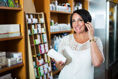 Woman with phone in store Stock Photos