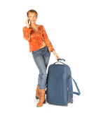 Woman on phone with suitcase Stock Images