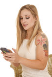 Woman with phone text tattoo Royalty Free Stock Photo