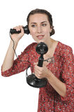 Woman on the phone. Woman using an old timey vintage candlestick phone Stock Photos