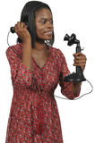 Woman on the phone. Woman using an old timey vintage candlestick phone Stock Images