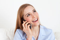 Woman on phone waiting for assistance Stock Image