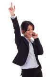 Woman on the phone winning stock photography