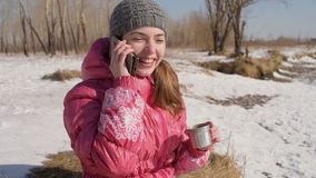 Woman with a phone in winter stock video footage