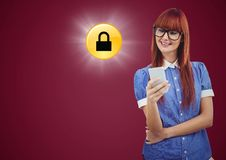 Woman with phone and yellow lock graphic with flare against maroon background Royalty Free Stock Image