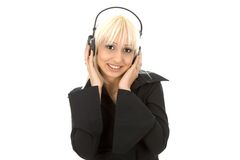 Woman with phones. Beutifull young woman listening music with phones Royalty Free Stock Photo