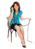 Woman phoning. Seated woman phoning with cables over her body Royalty Free Stock Photo