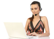 Woman phoning in front of a laptop computer Royalty Free Stock Photos