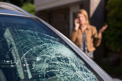 Woman Phoning For Help After Car Windshield Has Broken Royalty Free Stock Photography
