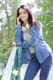 Woman phoning in nature Royalty Free Stock Photography