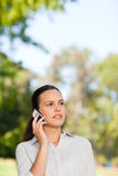 Woman phoning in the park Royalty Free Stock Image