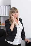 Woman is phoning with a smartphone Royalty Free Stock Photography