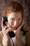 Woman is phoning with a vintage phone. Beautiful woman is phoning with a vintage phone Royalty Free Stock Photo