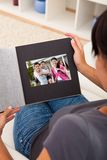Woman with photo album Royalty Free Stock Photography