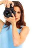 Woman with photo camera. Young woman with photo camera. Isolated over white background Stock Photo