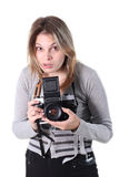 WOMAN WITH PHOTO CAMERA. The woman holds the big camera in hands Royalty Free Stock Photos