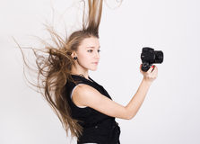 Woman with a photo camera Royalty Free Stock Photos