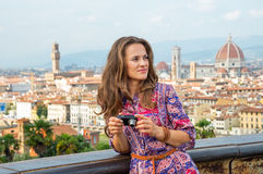 Woman with photo camera in florence, italy Stock Image