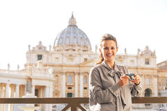 Woman with photo camera on piazza san pietro Stock Photography