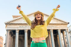 Woman with photo camera rejoicing  in rome Stock Photo