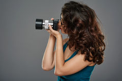 Woman with photo camera in a studio Stock Photography