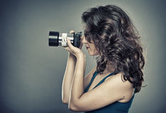 Woman with photo camera in a studio Stock Photo