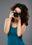 Woman with photo camera in a studio Royalty Free Stock Photo