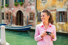 Woman with photo camera in venice, italy Royalty Free Stock Images