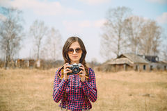 Woman with photo camera Stock Images