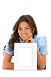 Woman with a photo frame Royalty Free Stock Photos