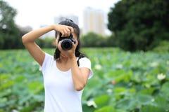 Woman photo grapher taking photo Stock Photo