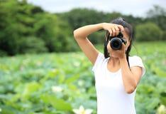 Woman photo grapher taking photo Royalty Free Stock Photos