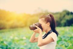 Woman photo grapher taking photo Royalty Free Stock Photo