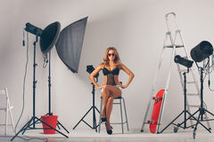 Woman in photo studio Stock Images