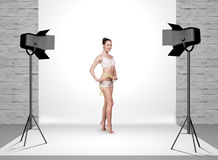Woman in photo studio with spotlights Royalty Free Stock Photo