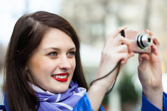 Woman with photocamera at travel destination Stock Photos
