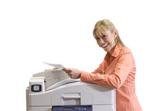 Woman at photocopier, smiling, portrait, cut out Stock Photo