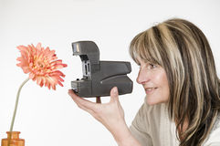 Woman photograph orange flower Stock Photo
