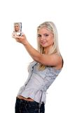 Woman photographed with a digital still camera Stock Image