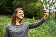 Woman photographed herself in the woods Royalty Free Stock Images