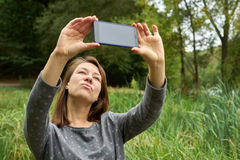 Woman photographed herself in the woods Royalty Free Stock Photography