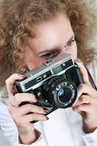 Woman photographer. Holding camera. Fashion stock photography